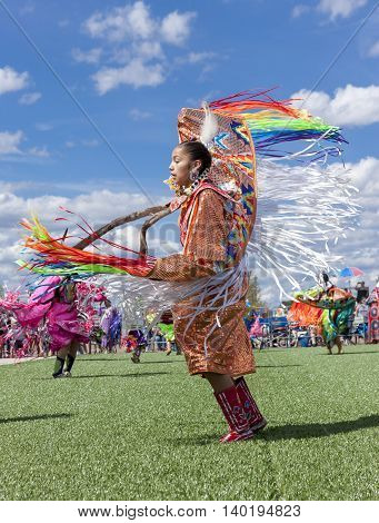 Coeur d'Alene Idaho USA - 07-23-2016. Young woman at powwow ceremony. Young dancer participates in the Julyamsh Powwow on July 23 2016 at the Kootenai County Fairgrounds in Coeur d'Alene Idaho.