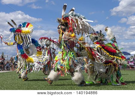 Coeur d'Alene Idaho USA - 07-23-2016. Native American men dancing at powwow. Young dancers participate in the Julyamsh Powwow on July 23 2016 at the Kootenai County Fairgrounds in Coeur d'Alene Idaho.