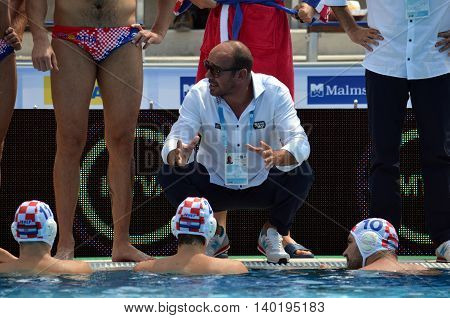 Budapest Hungary - Jul 14 2014. Ivica Tucak (head coach) talking to the croatian team. The Waterpolo European Championship was held in Alfred Hajos Swimming Centre in 2014.
