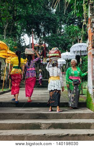 UBUD INDONESIA - MARCH 2: Balinese women with baskets on the heads during the celebration before Nyepi (Balinese Day of Silence) on March 2 2016 in Ubud Indonesia.