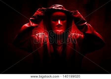 Dark doctrine,Mysterious woman wearing white mask under hoodie,Scary background for book cover