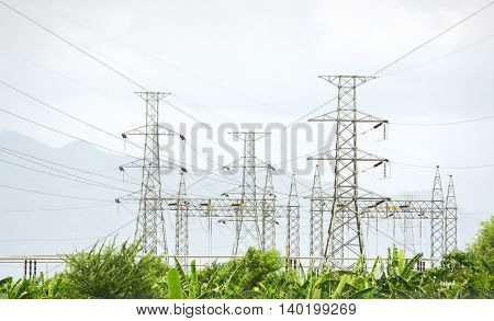 landscape of electric substation surrounded by green trees