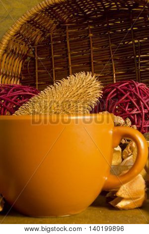 Potpourri and pottery on a wooden background