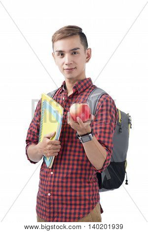 Asian student standing on white with book and apple. Back to school concept.