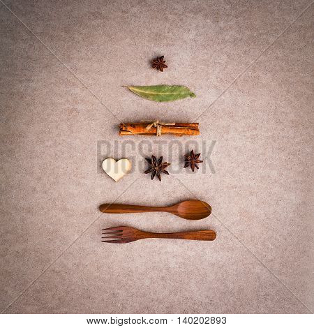 Background For Christmas Menu . Shape Of Christmas Tree From Wooden Spoon ,fork ,cinnamon ,star Anis