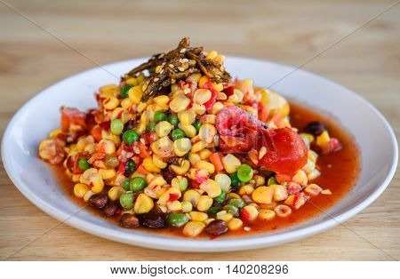 Som Tum or corn Salad Corn Pok Pok Thai Traditional Cuisine Popular Thai Food. Rustic still life style.