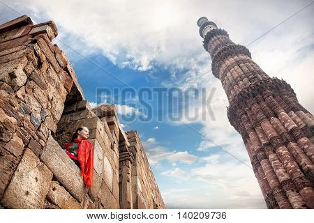 Woman In Red Dress At Qutub Minar Complex