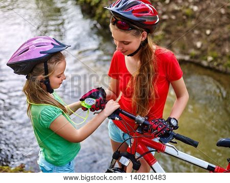 Girls with bicycle. Girls children ride bicycle. Girl in bicycling look at compass. Bicycle sport is good for health. Girl with bicycle looking compass.