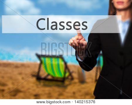 Classes - Businesswoman Pressing Modern  Buttons On A Virtual Screen