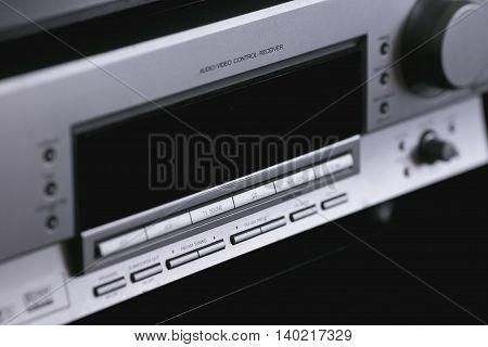 Vintage audio stereo rack with cassette tape deck receiver and speaker, angled view