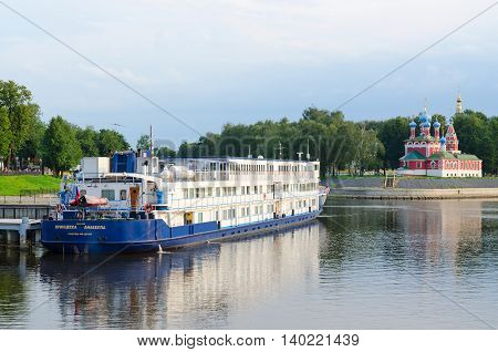 """UGLICH RUSSIA - JULY 19 2016: Cruise ship """"Princess Annabella"""" on river berth in old Russian town of Uglich Golden Ring of Russia"""