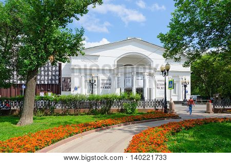 MOSCOW RUSSIA - JULY 23 2016: Unidentified people walk on Chistoprudniy boulevard near famous Moscow Order of Merit State Academic Theater Sovremennik