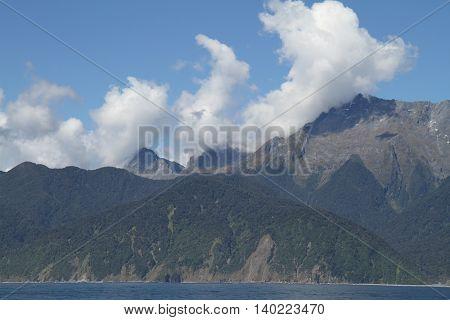 New Zealand Fjordland mountain panorama in sunshine 1
