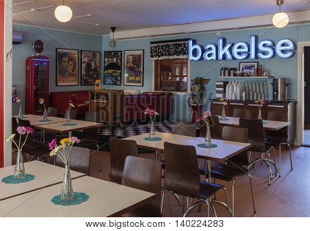 SVEG, SWEDEN ON JULY 08. Interior view of the Café Cineast on July 08, 2016 in Sveg, Sweden. Furnished in imaginative style, retro equipment from the film, movie world. Editorial use.