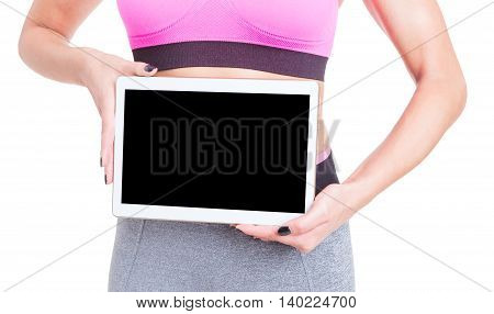 Close-up Of Fitness Trainer Holding Blank Screen Tablet