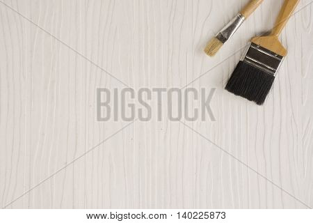Paint brush on white pattern background suitable for background paint or background diy or background decorate house and equipment or household.