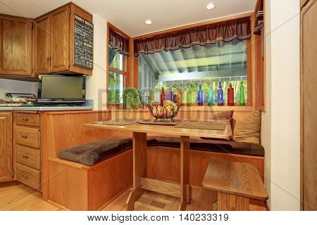 Small And Cozy Dining Area In The Kitchen Room.