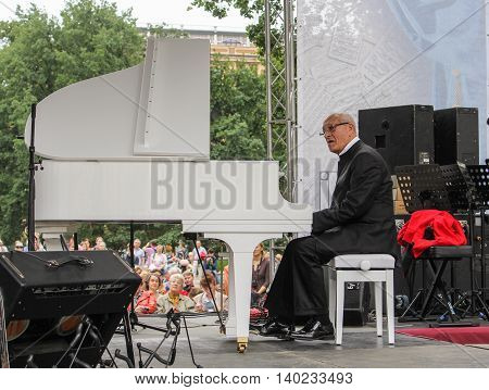 St. Petersburg, Russia - 23 July, Maestro at the piano, 23 July, 2016. Speech by David Goloschekin with his jazz group on the Arts Square in St. Petersburg.