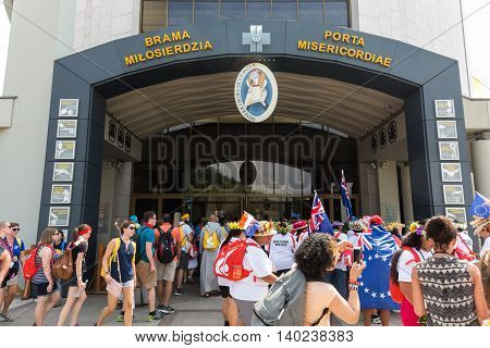 CRACOW POLAND - JULY 26 2016: World Youth Day 2016 - Pilgrims come across Door of Mercy in the Sanctuary of Divine Mercy in Lagiewniki. Cracow Poland