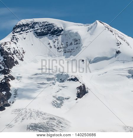 Cracks in the Snowfield give signs of a recent Avalanche