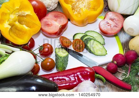 Background of fresh vegetables and greens closeup