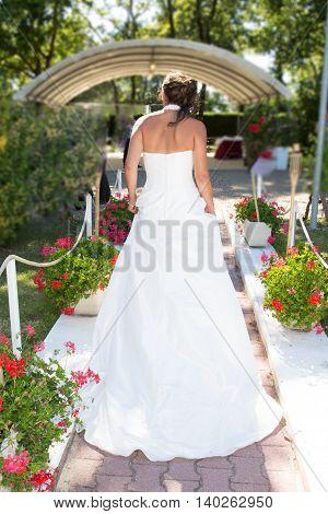 Runaway bride outside during her wedding day wedding dress