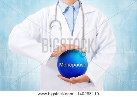 Doctor holding blue crystal ball with menopause sign on medical background. poster