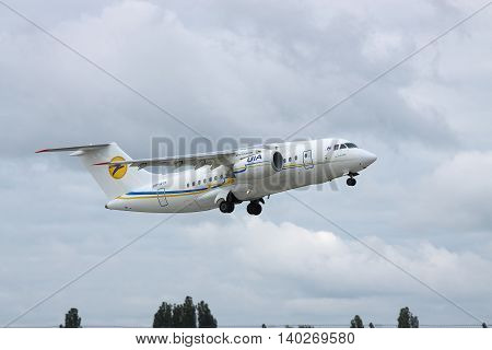 Borispol Ukraine - October 2 2011: Antonov An-148 regional passenger plane is taking off into cloudy sky