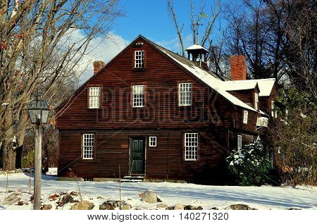 Sudbury Massachusetts - November 24 2014: The wooden colonial-era blacksmith shop at the historic Wayside Inn complex *