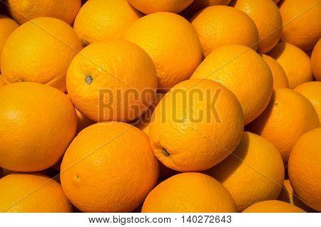 many orange fruits - pile orange fruit background