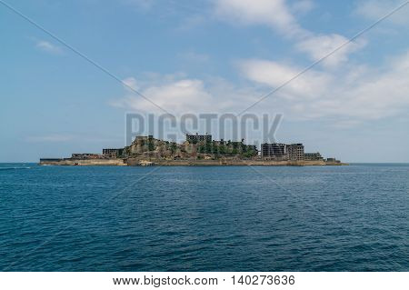 Gunkanjima (Hashima Island) in Nagasaki, Japan. Gunkanjima (meaning Battleship Island), is former coal mining island.  The island was formally approved as UNESCO World Heritage side in July 2015.