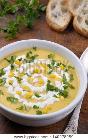 Puree soup mealies seasoned with grains of corn parsley and sour cream