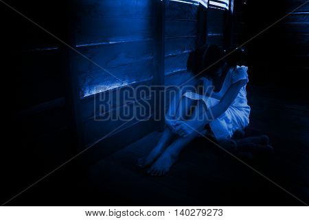 Children abuse concept or Ghost girl in haunted house,Horror background for book cover