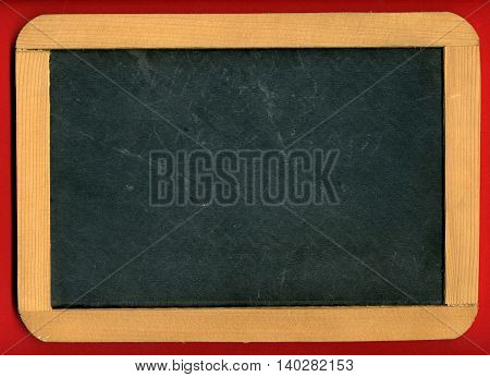 Image of little chalkboard on red background