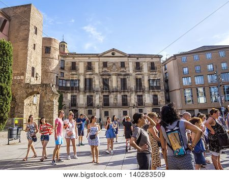 BARCELONA SPAIN - JULY 8 2016: People on the square of Cathedral of the Holy Cross and Saint Eulalia