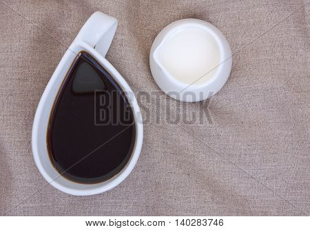 Cup Of Coffee On Linen Tablecloths With Creamer And Empty Place For Your Text. Close-up, A Top Plan