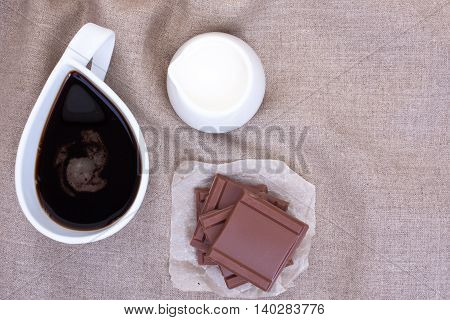 Cup Coffee On Linen Tablecloths With Pieces Of Chocolate, Creamer And Cream And Empty Place For Your