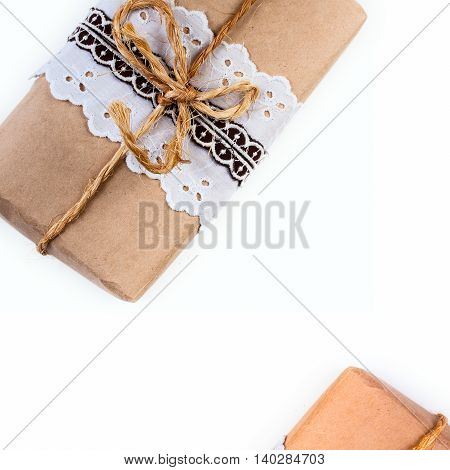 Background with gift box tied decorative lace ribbon and rope, twine.