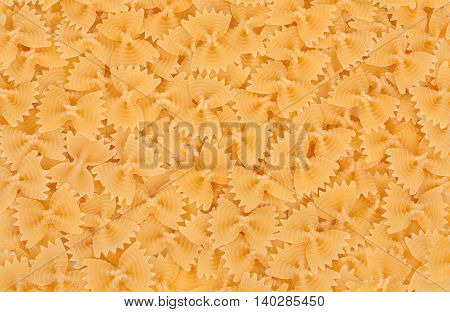 Background Italian Pasta, Pasta Made From Durum Wheat In The Shape Of A Butterfly Or Bowknot