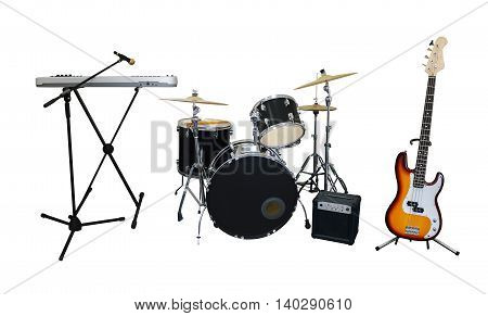 Set of musical instruments isolated on white background: guitar synthesizer combo amplifier and drums