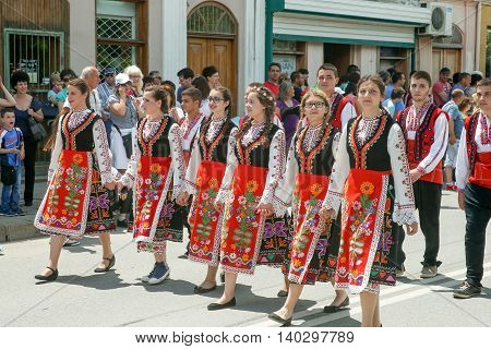 KAZANLAK, BULGARIA - JUNE 05, 2016: Young women are marching in national costumes. At the Rose Festival