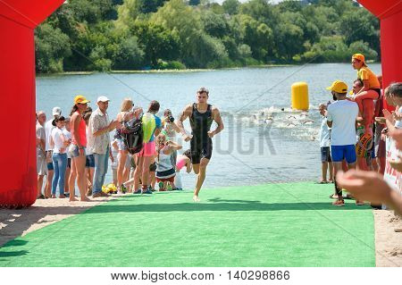 Triathlon Cup of Ukraine and Cup of Bila Tserkva. July 24 2016 in Bila Tserkva Ukraine. The leader of race runs to the following stage