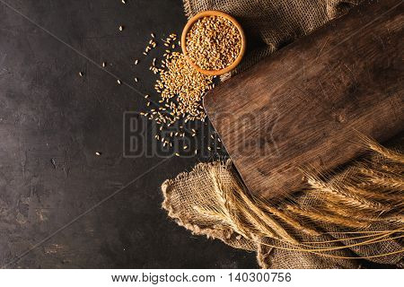 Wooden board for bread. Wheat and wheat-ears around