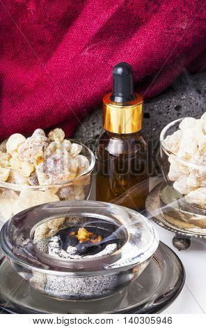 Bottle with organic essential aroma oil from Frankincense tree (Boswellia sacra) tree resin and Frankincense incense.