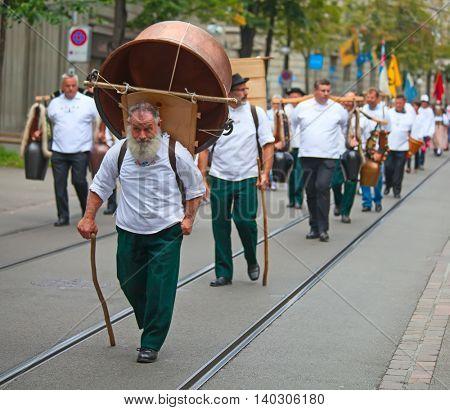 ZURICH - AUGUST 1: Swiss National Day parade on August 1, 2011 in Zurich, Switzerland. Representative of canton Glarus in a historical costume.