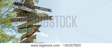 mileage signpost on key west florida beach florida tropical banner background Ancient pointer distances in different directions