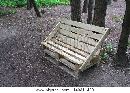 Bench made of wooden pallets in the park