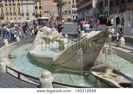 Rome Italy - June 29 2016: tourists visiting the Piazza di Spagna in Rome. Tourists around the fountain