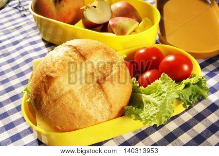 Cooking lunchbox - sandwich with cheese and fresh vegetables (pepper, tomatoes, lettuce)