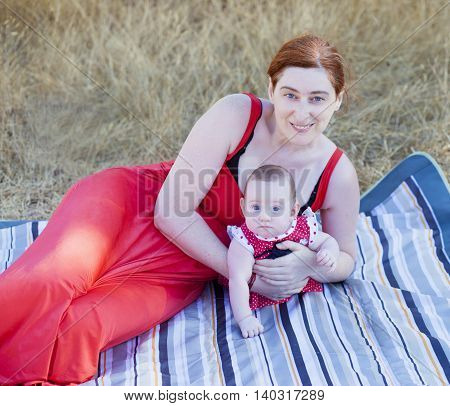 Mother And Daughter Dressed In Red